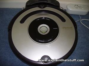 Roomba robot vacuum cleaner docked in its charging station.