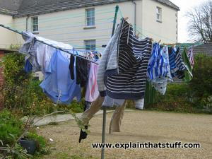 Clothes on an outdoor rotary clothes dryer.