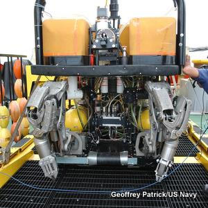 Super Scorpio remotely operated vehicle onboard a ship. Front view showing the robotic manipulator arms.