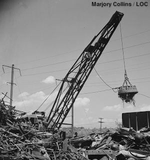 Scrapyard electromagnet, black and white, by Marjory Collins.