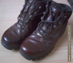 polished gore-tex walking boots reflecting light like a mirror