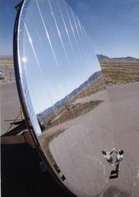 A silver heliostat mirror reflecting solar energy in a furnace in New Mexico