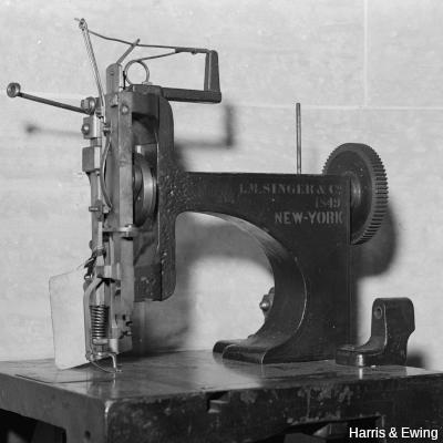 Model of an early Singer sewing machine, photo by Harris & Ewing, LoC.
