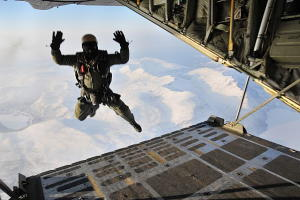 A US Navy SEAL skydiver freefalls from the back of a plane.