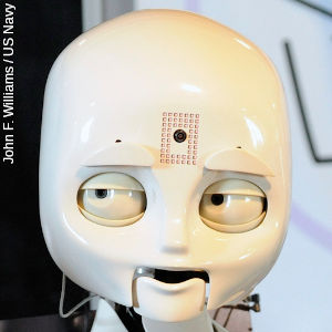 Closeup of the head of Octavia, a social robot.