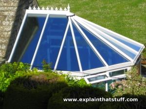 Blue, self-cleaning, heat-reflecting glass keeps a conservatory cool.