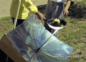 Cooking eggs with a solar cooker reflector.