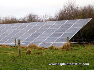 Large tilted solar panel on a solar farm with sky background