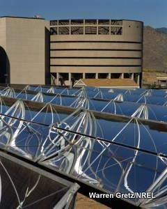 Photo of solar-thermal energy collectors using mirrors and water pipes.
