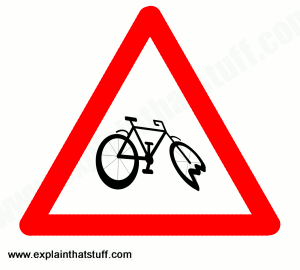 Cycle route sign showing crashed bicycle with buckled wheel