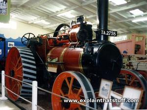 A steam traction engine in a museum