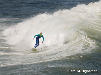 Surfer in blue/green wetsuit riding a wave, by Carol Highsmith