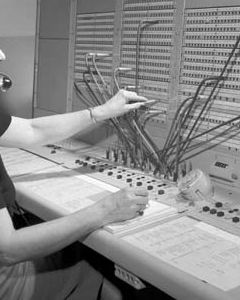 A typical female telephone switchboard operator.