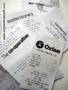 Photo: Thermal printer checkout receipts from various stores.
