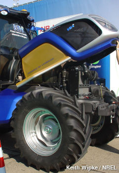 Blue New Holland tractor with its fuel cell open and visible under the hood.