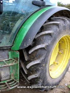 Closeup photo of John Deere tractor tires.