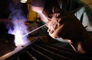 Welding metals with a Tungsten Inert Gas (TIG) welder.