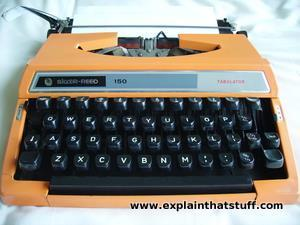 Portable orange Silver Reed Tabulator manual typewriter from around 1978