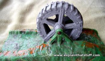 A model of an undershot water wheel showing the flywheel-like design of spokes and thick outer rim.