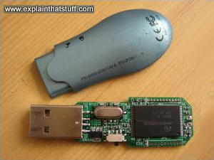 USB memory stick with the top case removed, showing a chip inside