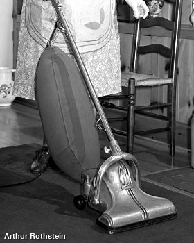 A vintage Singer bag vacuum cleaner photographed in 1942 by Arthur Rothstein.