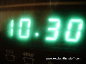 Green vacuum fluorescent display showing the time on a stove.