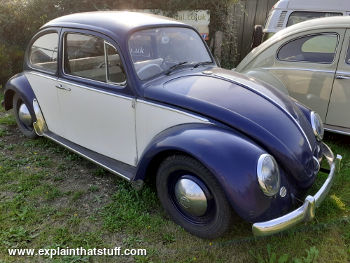Two-tone blue and white VW Beetle seen from the side.