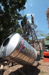 Large water tank being installed.