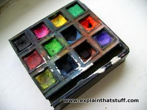 Small watercolor paints in a block palette