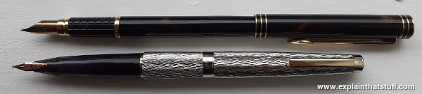 White silver and Sheaffer and Waterman fountain pens.
