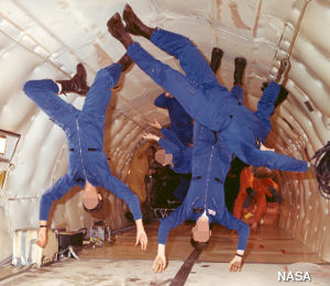 NASA astronauts practice floating in weightlessness in the KC-135 vomit comet simulator airplane.