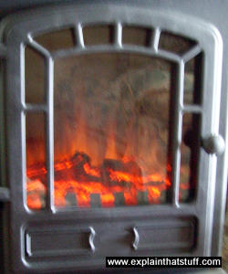 Glowing coals in a typical wood-burning biomass stove.
